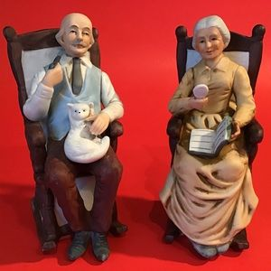 ELDERLY MAN AND WOMAN IN ROCKING CHAIRS FIGURINES